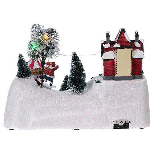 Scena natalizia musicale con giostra 20x30x15 cm 5