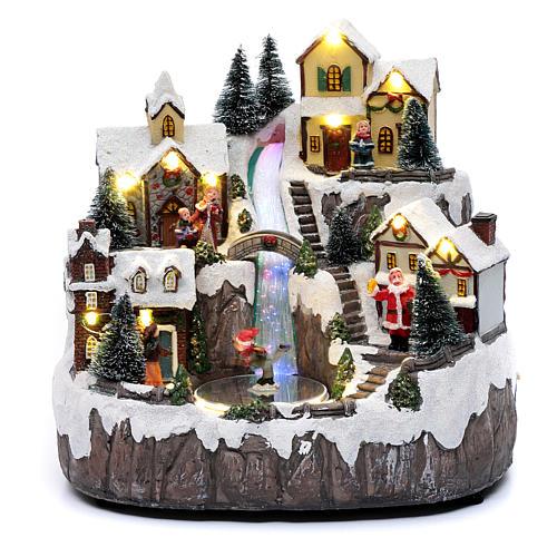 Villaggio di Natale con ruscello di fibra e musica 25x25x17 cm 1