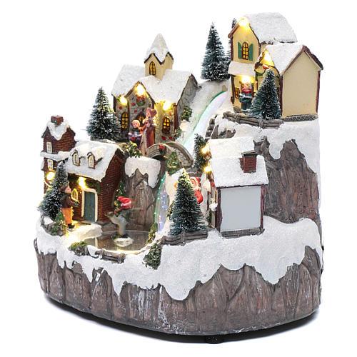 Villaggio di Natale con ruscello di fibra e musica 25x25x17 cm 2