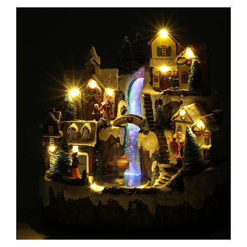 Villaggio di Natale con ruscello di fibra e musica 25x25x17 cm 4