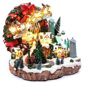 Scena natalizia con luci e treno in movimento 30x30x25 cm s3