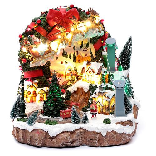 Scena natalizia con luci e treno in movimento 30x30x25 cm 1