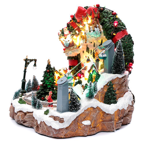 Scena natalizia con luci e treno in movimento 30x30x25 cm 2