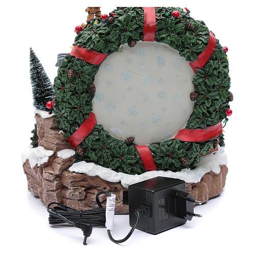 Scena natalizia con luci e treno in movimento 30x30x25 cm 5