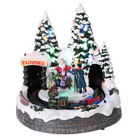 Christmas village with moving train and photographer  20x20x20 cm s1