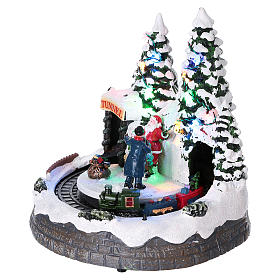 Christmas village with moving train and photographer  20x20x20 cm s3