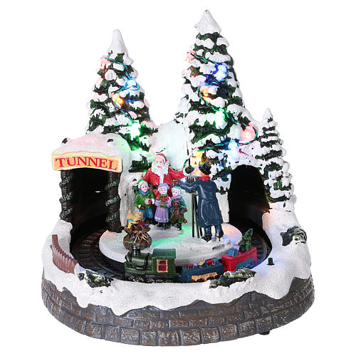 Christmas village with moving train and photographer  20x20x20 cm 1
