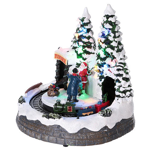 Christmas village with moving train and photographer  20x20x20 cm 3