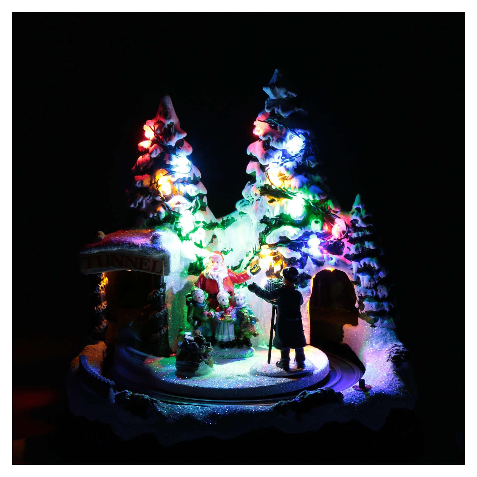 Paisaje navideño con tren en movimiento y fotografo 20x20x20 cm 3