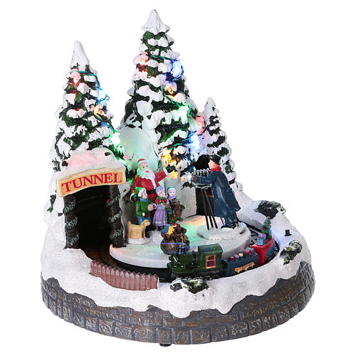 Christmas village with moving train and photographer  20x20x20 cm 4