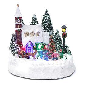 Paisaje de Navidad iluminado con niños en movimiento 20x20x15 cm s1