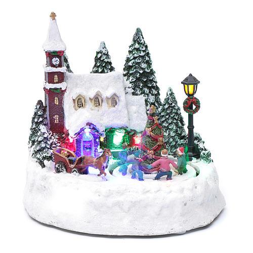 Paisaje de Navidad iluminado con niños en movimiento 20x20x15 cm 1