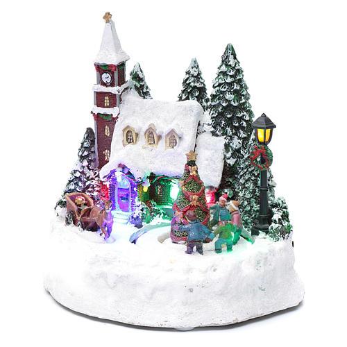 Paisaje de Navidad iluminado con niños en movimiento 20x20x15 cm 2