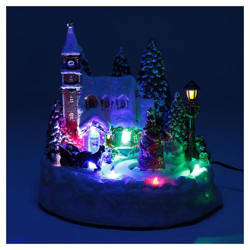 Paisaje de Navidad iluminado con niños en movimiento 20x20x15 cm 4