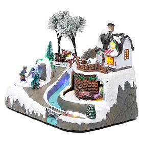 Village Noël musique 20x25x20 cm enfants qui patinent en mouvement s2
