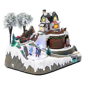 Village Noël musique 20x25x20 cm enfants qui patinent en mouvement s3
