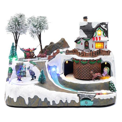 Village Noël musique 20x25x20 cm enfants qui patinent en mouvement 1