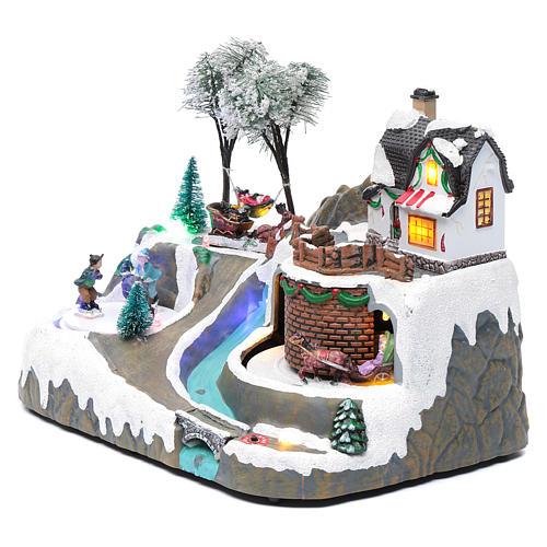 Village Noël musique 20x25x20 cm enfants qui patinent en mouvement 2