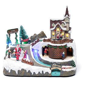 Villaggio Natalizio musica 20x25x20 cm Babbo Natale ed elfi in movimento s1