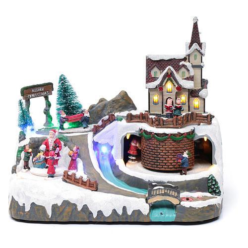 Villaggio Natalizio musica 20x25x20 cm Babbo Natale ed elfi in movimento 1