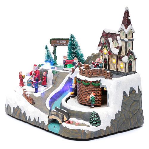 Villaggio Natalizio musica 20x25x20 cm Babbo Natale ed elfi in movimento 2