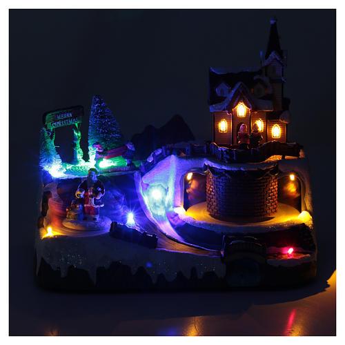 Villaggio Natalizio musica 20x25x20 cm Babbo Natale ed elfi in movimento 4