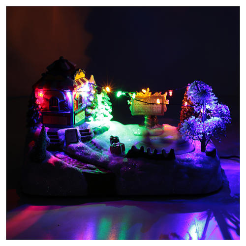 Paisaje de Navidad con parque en movimiento música y luces led 20x25x15 cm 4