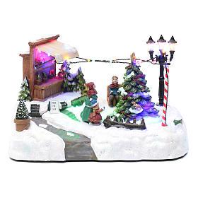 Paisaje de Navidad con negocio navideño música y árbol en movimiento 20x25x20 cm s1