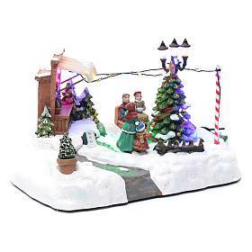 Paisaje de Navidad con negocio navideño música y árbol en movimiento 20x25x20 cm s3