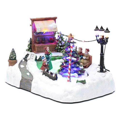 Paisaje de Navidad con negocio navideño música y árbol en movimiento 20x25x20 cm 2