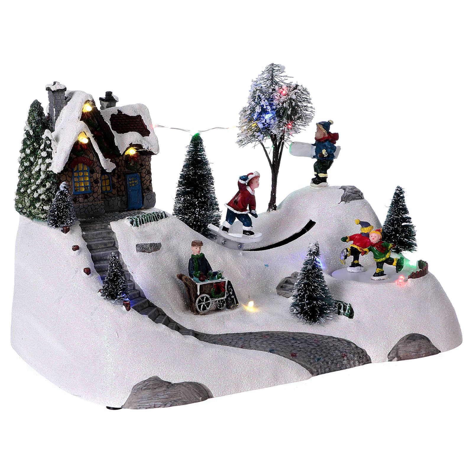 Scenka bożonarodzeniowa z melodyjką ruchomym torem skejta i lodowiskiem 20x30x15 cm 3