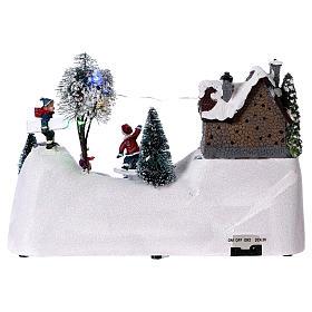 Scenka bożonarodzeniowa z melodyjką ruchomym torem skejta i lodowiskiem 20x30x15 cm s5