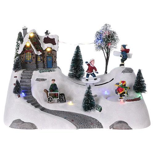Scenka bożonarodzeniowa z melodyjką ruchomym torem skejta i lodowiskiem 20x30x15 cm 1