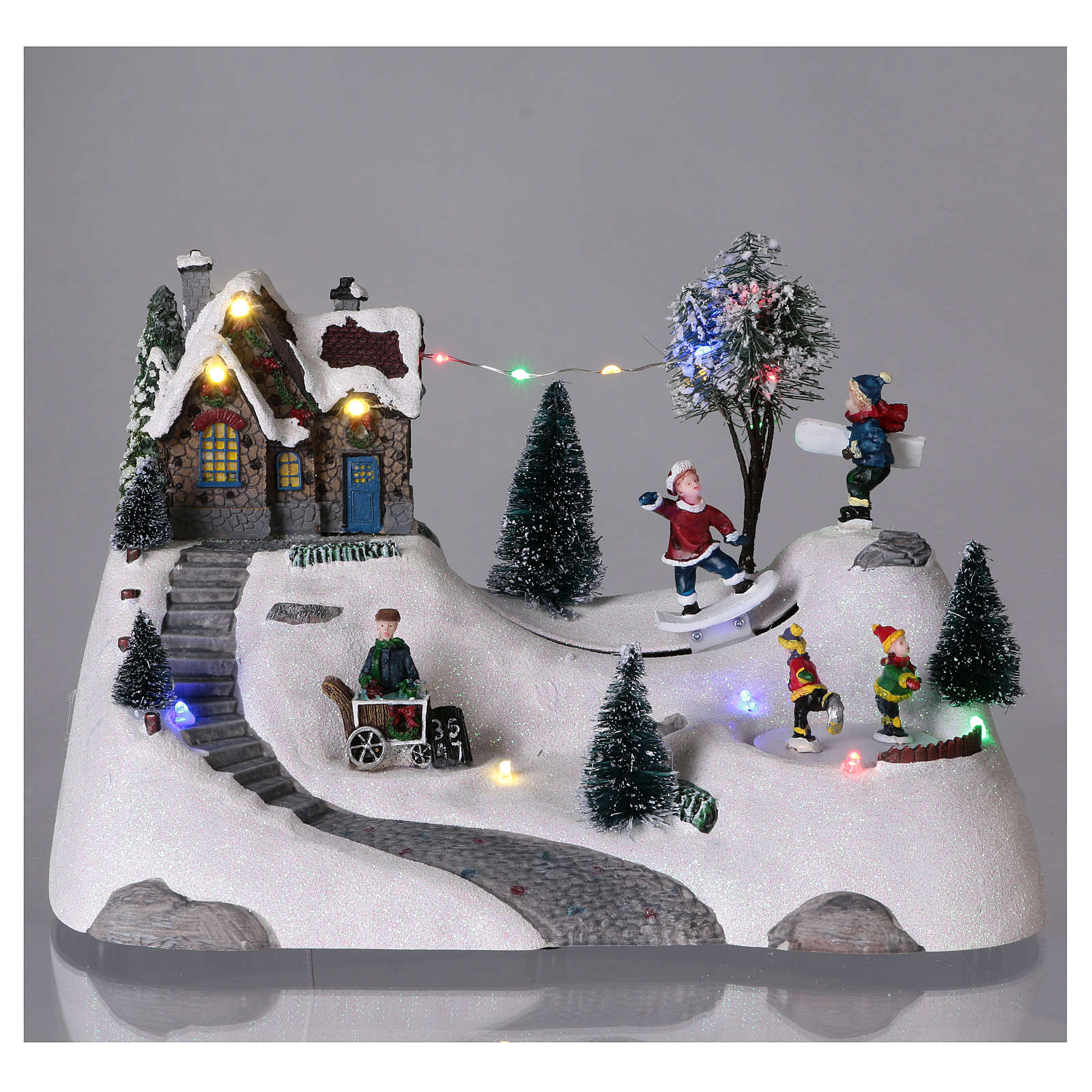 Moving christmas scene with music and ice skating rink 20x30x15 cm 3