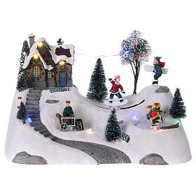 Moving christmas scene with music and ice skating rink 20x30x15 cm s1