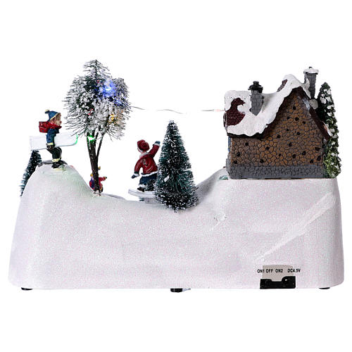 Moving christmas scene with music and ice skating rink 20x30x15 cm 5