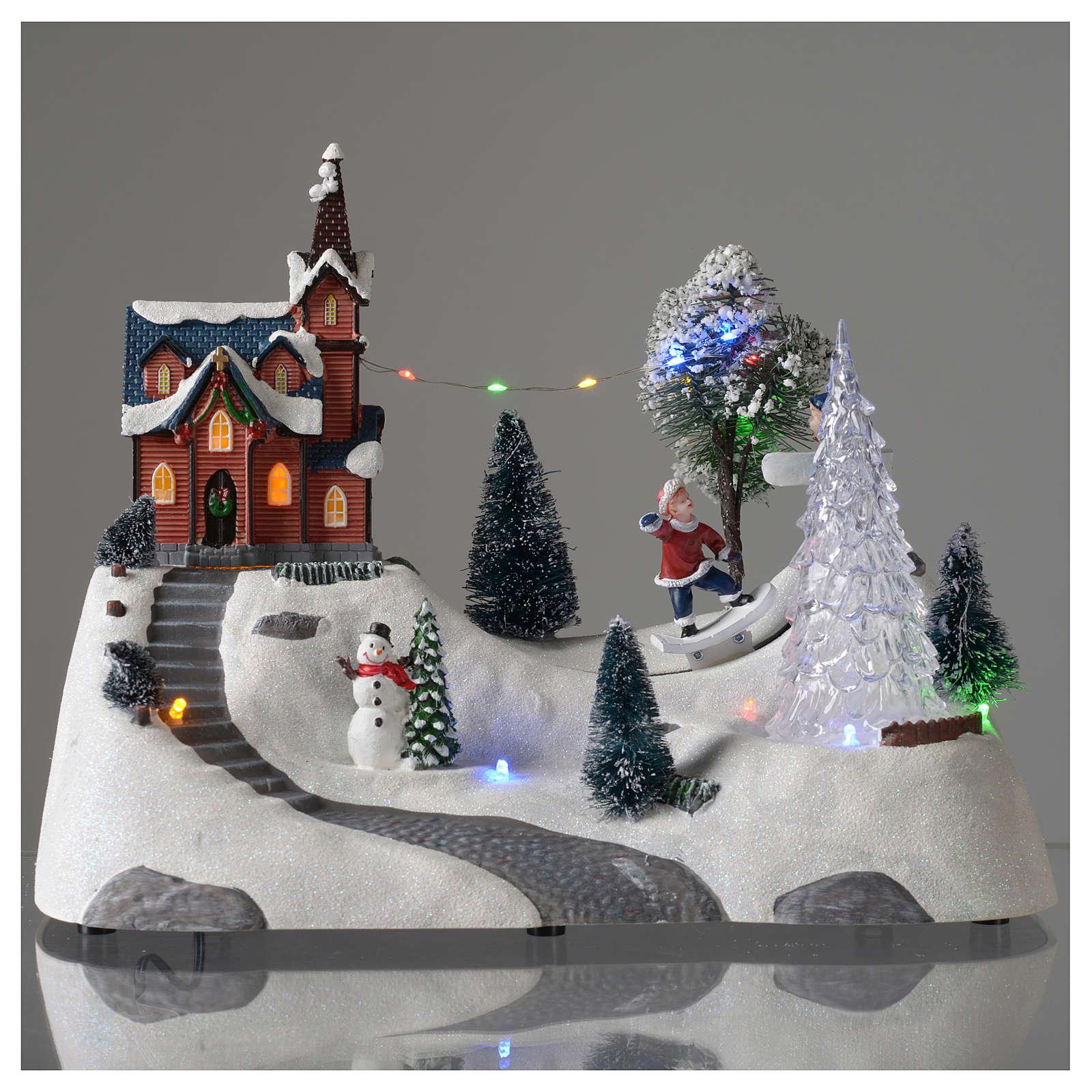 Paisaje de Navidad con música, iglesia, muñeco de nieve y árbol en movmimento 20x30x15 cm 3