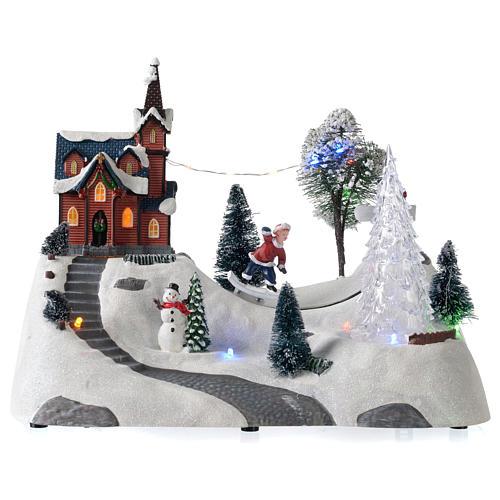 Paisaje de Navidad con música, iglesia, muñeco de nieve y árbol en movmimento 20x30x15 cm 1