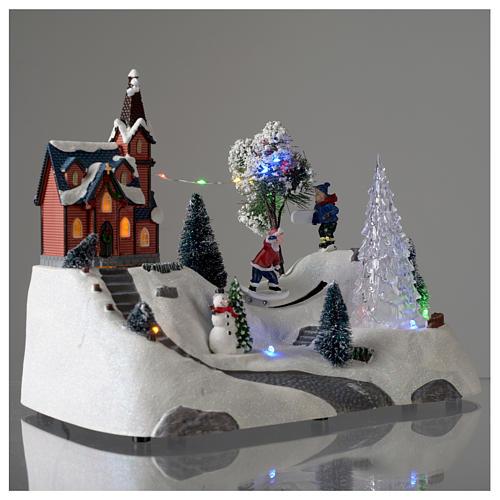 Paisaje de Navidad con música, iglesia, muñeco de nieve y árbol en movmimento 20x30x15 cm 4