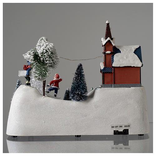 Paisaje de Navidad con música, iglesia, muñeco de nieve y árbol en movmimento 20x30x15 cm 5