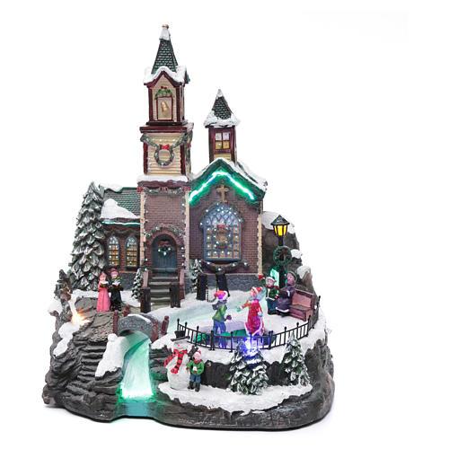 Villaggio natalizio musicale illuminato lago ghiacciato movimento 38X28X30 cm 1