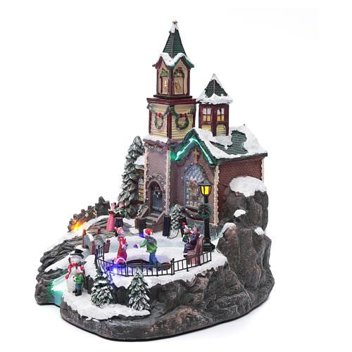 Villaggio natalizio musicale illuminato lago ghiacciato movimento 38X28X30 cm 2