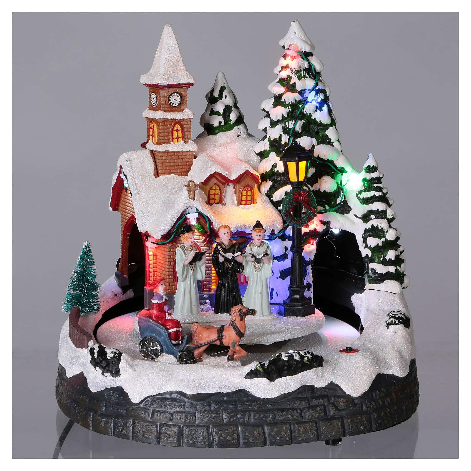 Aldea navideña iluminada musical movimiento carruajes 20x19x18 cm 3