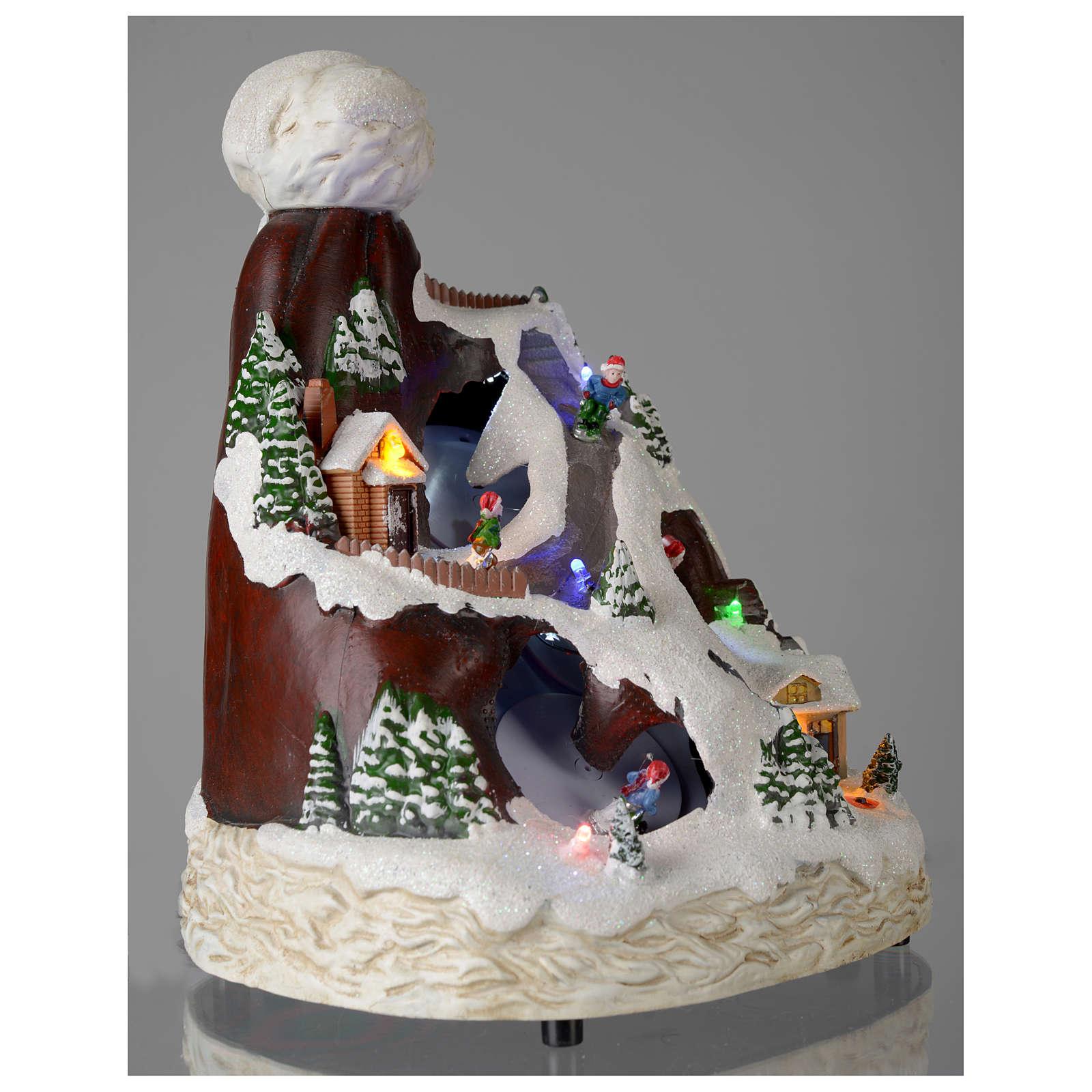 Aldea navideña sombrero luces musical movimiento esquiadores 24x19x19 cm 3