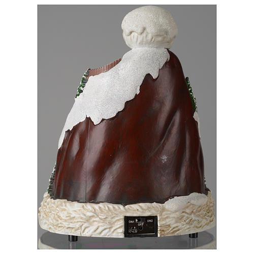 Aldea navideña sombrero luces musical movimiento esquiadores 24x19x19 cm 5