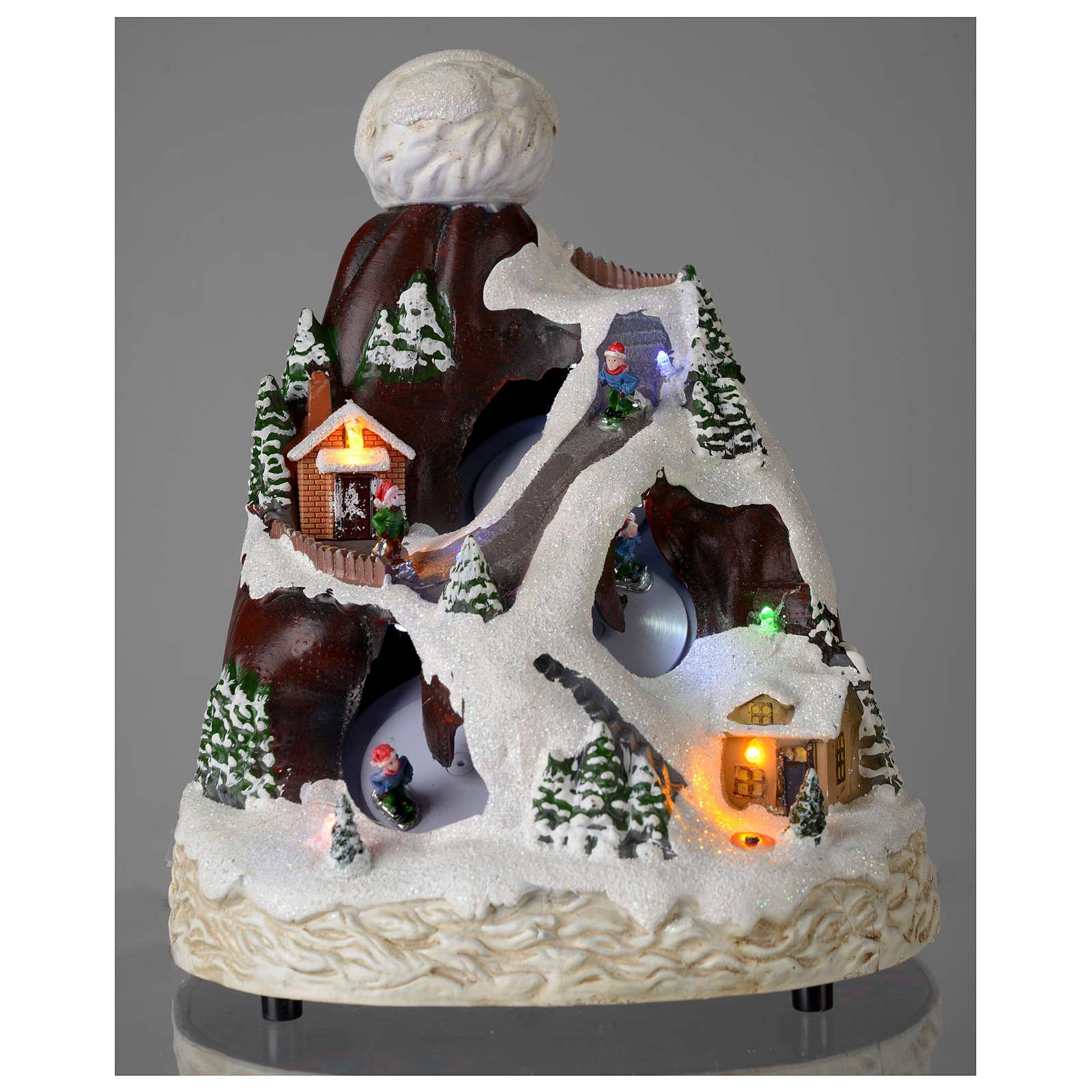 Village Noël bonnet lumière musique mouvement skieurs 24x19x19 cm 3