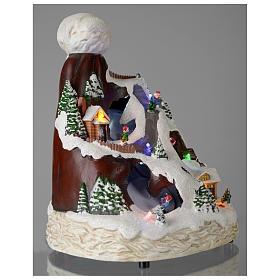 Village Noël bonnet lumière musique mouvement skieurs 24x19x19 cm s4