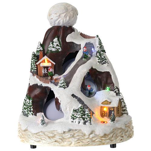 Village Noël bonnet lumière musique mouvement skieurs 24x19x19 cm 1