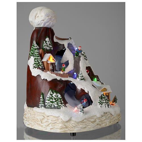 Villaggio natalizio cappello luci musicale movimento sciatori 24X19X19 cm 4