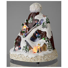 Christmas village hat shaped, with lights, music, movement and skiers 24X19X19 cm s3